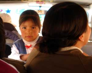 Little Bolivian girl in the typical means of transportation - collectivo, Bolivia, 14. 2. 2006
